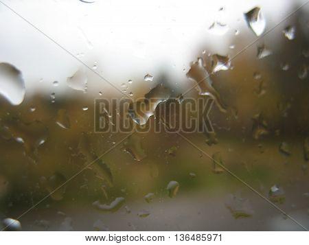 Window Glass And Rain Drops