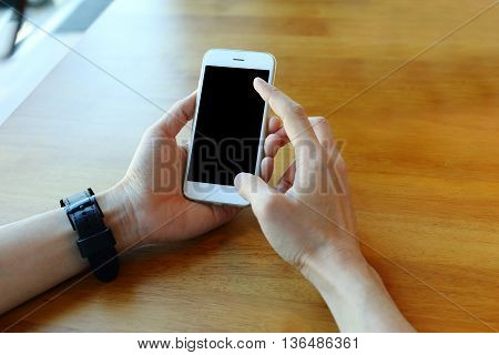 Hand holding smartphone with touch on screen