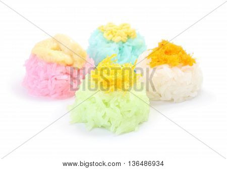 Multiple color of sticky rice with sugar custard on white floor.