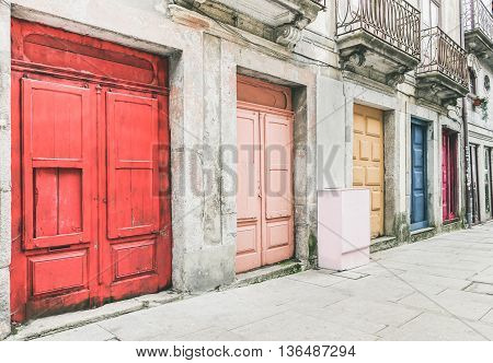 The old town of Porto in Portugal - Street view of colorful doors - Vintage editing with main focus in the middle of the frame