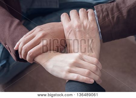3 hand Assemble Corporate Meeting /Teamwork for business