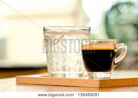 Cup of coffee with cool drink on wood pleate in vintage color