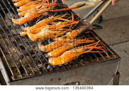 shrimp on the grill with hand.  prep, fresh