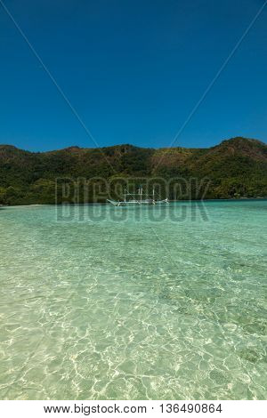 Tropical island and cristal clear water of Indian ocean, Philippines