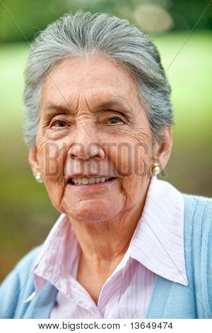 Portrait of a lovely old woman smiling outdoors