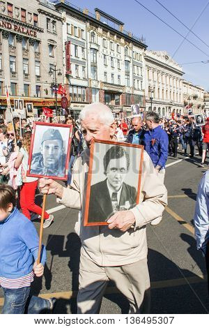 St. Petersburg, Russia - 9 May, An elderly man with portraits of loved ones, 9 May, 2016. Holiday-action