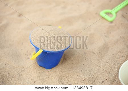 Sand beach in a blue color bucket