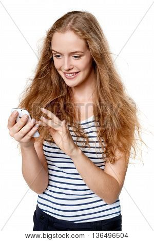 Young woman texting on her cell phone smiling happy
