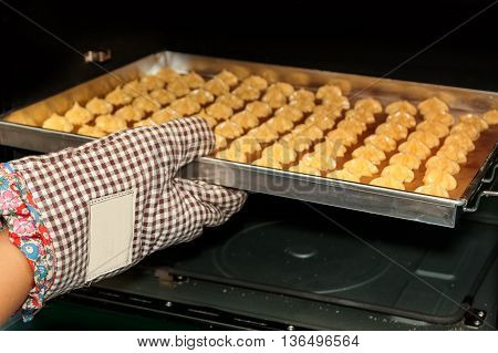 Choux cream in the hot oven, home bakery