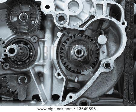 Part of old motorcycle inner detail engine parts in bike repair shop selective focus (vintage effect)