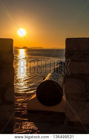 Cannon in the sunset in Hydra, Greece
