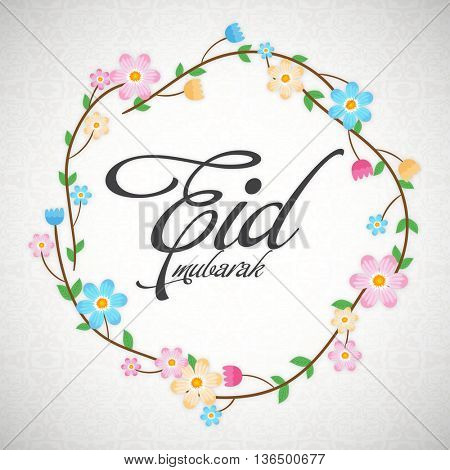 Beautiful Flowers decorated Greeting Card design, Eid Mubarak Typographical Background, Creative vector illustration for Muslim Community Holy Festivals celebration.