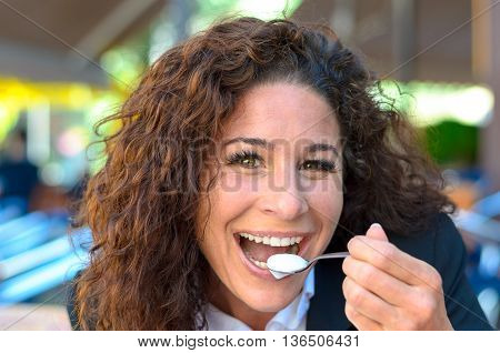 Happy Beaming Woman Eating Cream