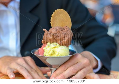 Woman Holding A Multi Flavored Ice Cream Sundae