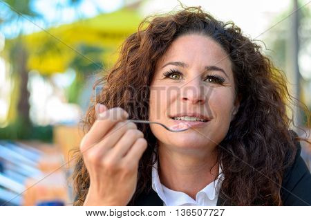Attractive Woman Savoring Ice Cream