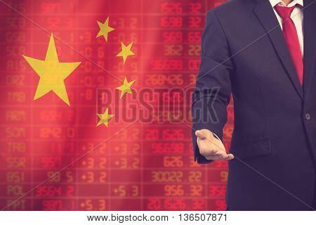 Flag Of China. Downtrend Stock Data Diagram With Business Man With Empty Hand Vintage Color