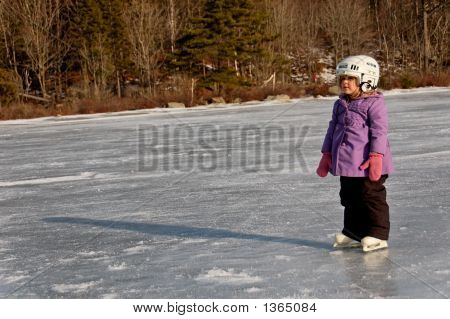 Youg Girl Standing On Ice Lake