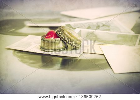 Old photographs with small decorative box with a heart