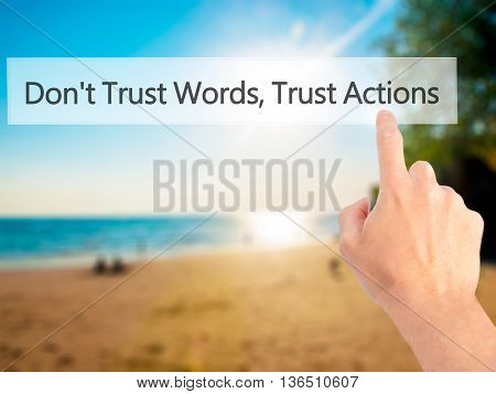 Don't Trust Words, Trust Actions - Hand Pressing A Button On Blurred Background Concept On Visual Sc