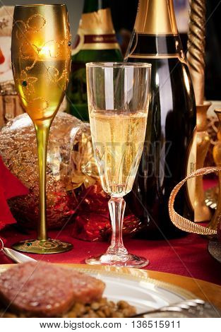 A Glass Of Champagne On A Decorated Christmas Day Dinner Table