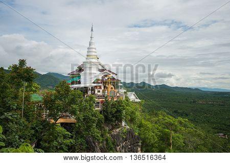 Pagoda on the mountain wat phra phutthabat PhanamLilamphunthailand..