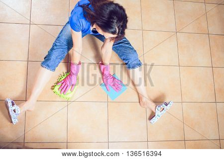 Woman cleaning kitchen. Portrait Of Young Woman Mopping Floor At Home