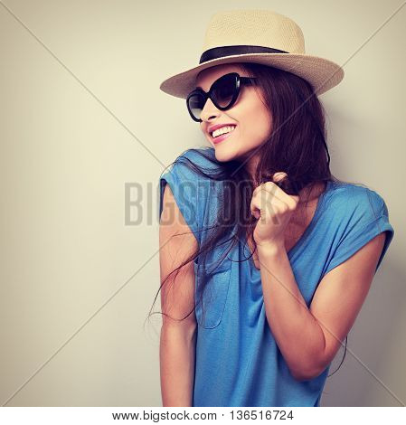 Happy Enjoyment Young Woman In Sun Glasses And Hat Posing. Vintage Toned Portrait
