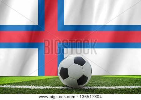 Soccer Ball And National Flag Of Faroe Islands Lies On The Green Grass