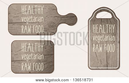 Wooden breadboard with the words healthy vegetarian raw food