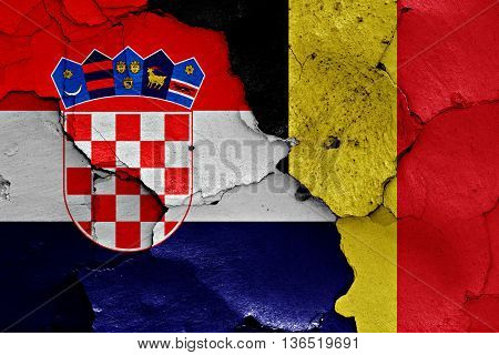 Flags Of Croatia And Belgium Painted On Cracked Wall