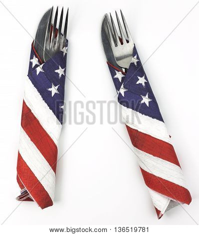 Pair of silverware wrapped in American flag napkins