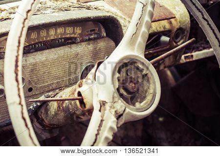 vintage dashboard on an abandoned car in sweeden