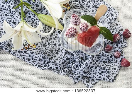 delicious, sweet dessert, ice cream with raspberries, on a background of beautiful flowers