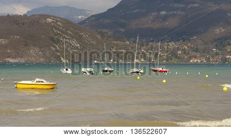 a view of Annecy lake with sailboats