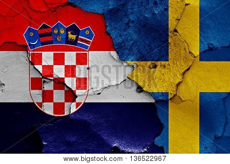 Flags Of Croatia And Sweden Painted On Cracked Wall