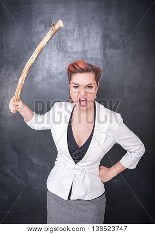 Angry Screaming Teacher With Wooden Stick On Blackboard