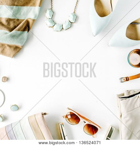 flat lay feminini clothes and accessories collage with cardigan trousers sunglasses watch bracelet lipstick mint high heel shoes earrings and purse on white background.
