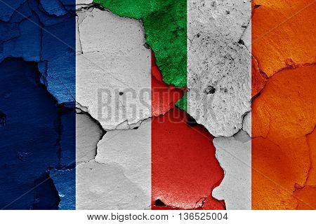 Flags Of France And Ireland Painted On Cracked Wall