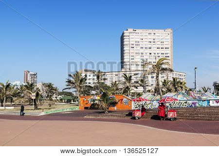 Ice Cream Vendors On Promenade Against City Skyline