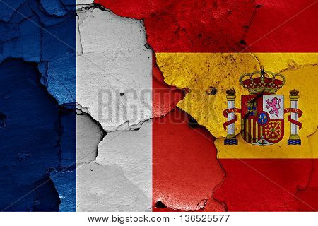 Flags Of France And Spain Painted On Cracked Wall