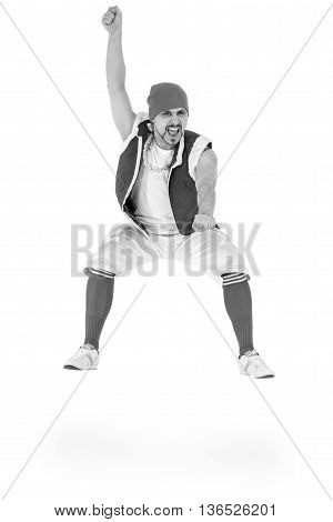 colorless portrait of friendly man dressed like a funny gnome jumping Isolated on white background in full length.