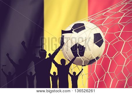 Silhouettes Of Soccer Fans With Flag Of Belgium.cheer Concept Vintage Color