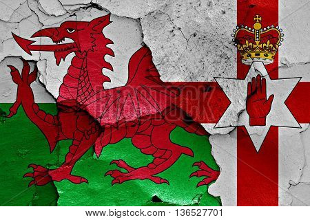 Flags Of Wales And Northern Ireland Painted On Cracked Wall