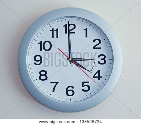 Isolated electronic wall clock. Goes to Summer time