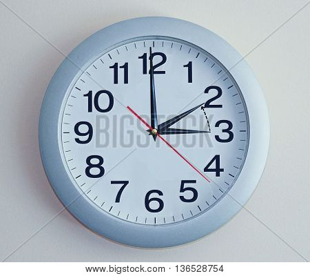 Isolated electronic wall clock. Goes to Winter time