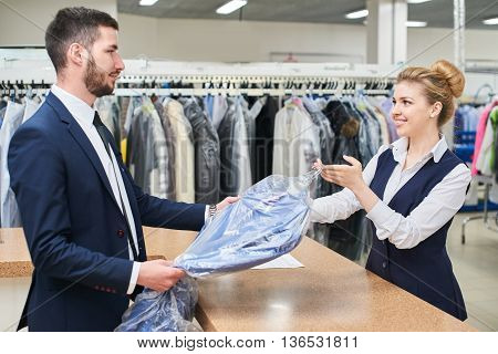 Male client takes a woman Laundry worker clean clothes at the dry cleaners