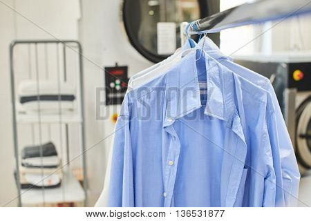 Girl worker Laundry ironed clothes iron dry
