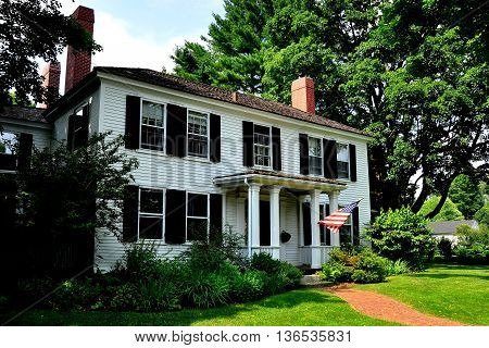 Lexington Massachusetts - July 10 2013: 18th century colonial home opposite the Village Green where the first shots of the American Revolution were fired on 19 April 1775 *