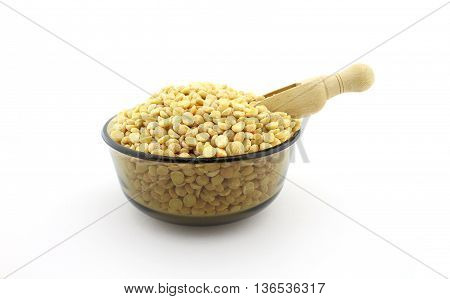 Peas beens in bowl, with wooden spoon