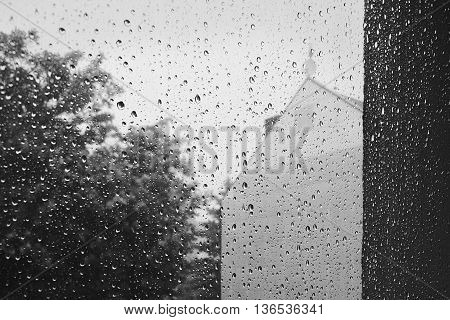 black and white photo of rainy day outside the window in Chomutov city in Czech republic